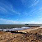 Blue Sky And A Beach - Walton On Naze Essex  by J J  Everson