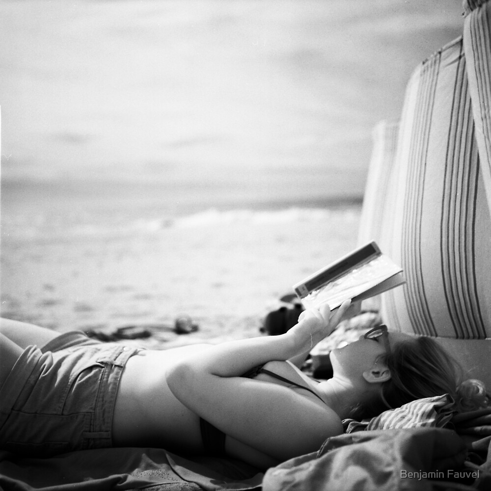 A woman reads on the beach - Another World by Benjamin Fauvel
