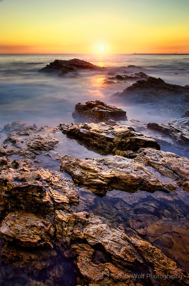 Sunset Corona Vertical by jswolfphoto