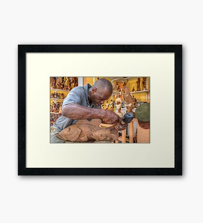 Bahamian Sculptor carving the Wood at the Straw Market in Nassau Framed Print
