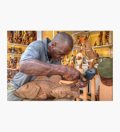 Bahamian Sculptor carving the Wood at the Straw Market in Nassau Photographic Print