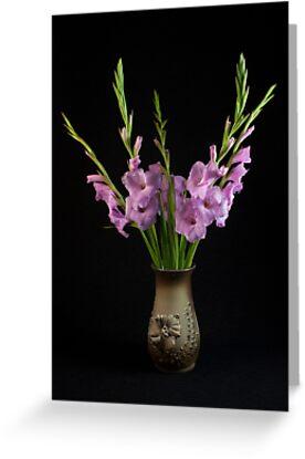 Gladioli in a vase by Gundars Helds