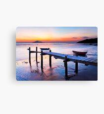 Sunset coast at wooden pier Canvas Print