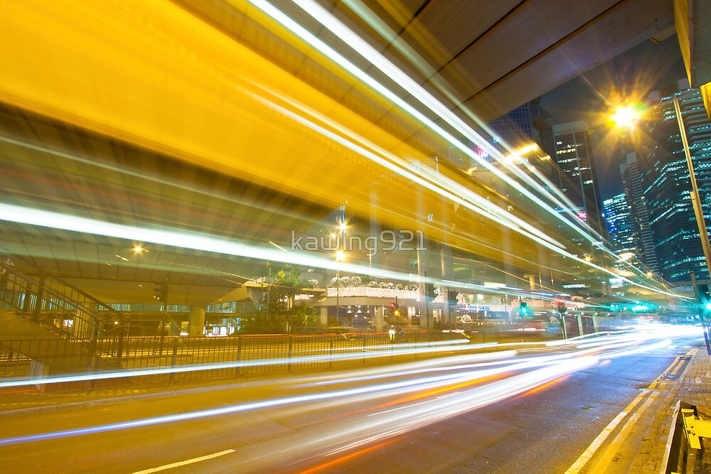 Traffic in modern city at night by kawing921