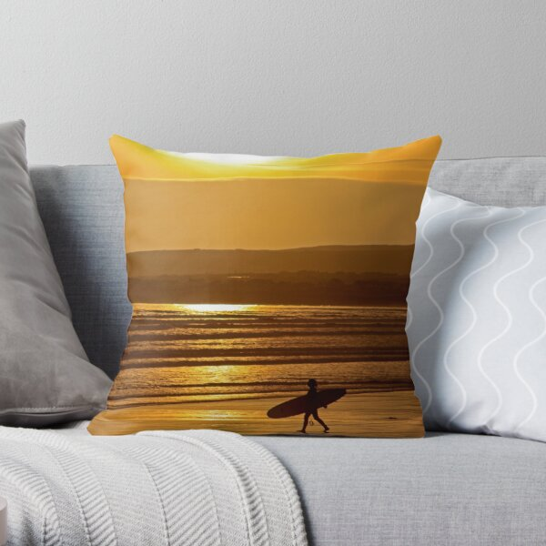 Surf girl walking on beach at sunset  Throw Pillow