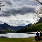 Two friends share a view over Buttermere Lake, Lake District by Elana Bailey