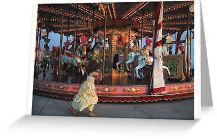 Girl plays with carousel by Esmé Lammers