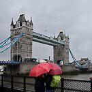 Umbrella admiration - Tower Bridge - London - Britain by Norman Repacholi