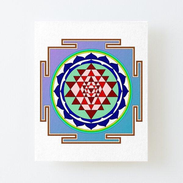 The Sri Yantra is a form of mystical diagram, known as a yantra, found in the Shri Vidya school of Hindu tantra. Canvas Mounted Print