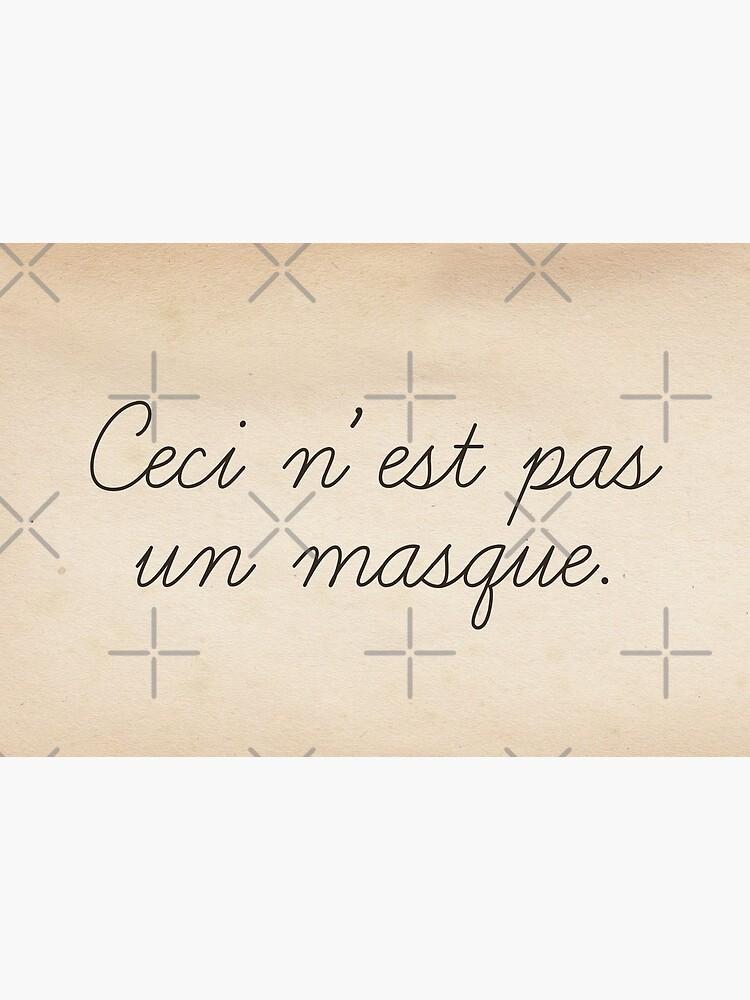 Magritte quote surrealist art style funny text. Ceci n'est pas un masque by cinemadnesshirt