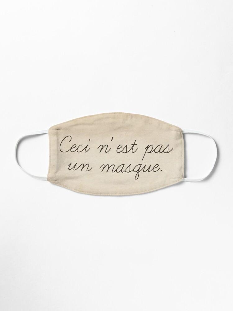 Alternate view of Magritte quote surrealist art style funny text. Ceci n'est pas un masque Mask