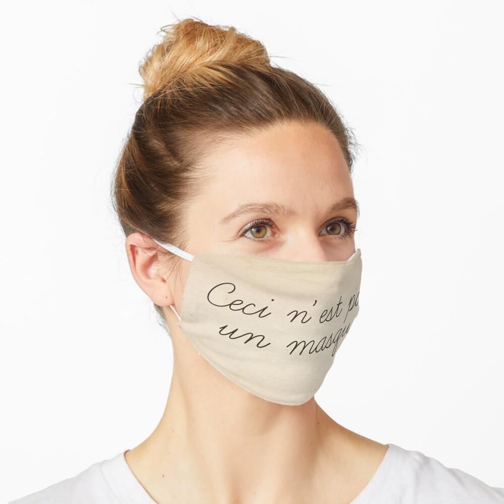 Magritte quote surrealist art style funny text. Ceci n'est pas un masque Mask