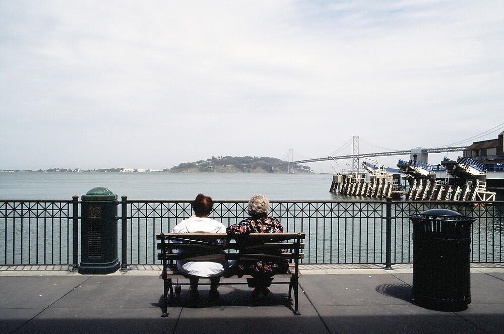 Two Women Sitting by Tara Holland