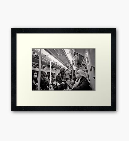 Riding the Tube - London - Britain Framed Print