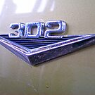 302 Badge On A Ford Falcon Xp by Russell Voigt