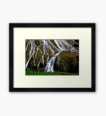 Flowing waterfall taken with slow shutter speed for calming effect Framed Print
