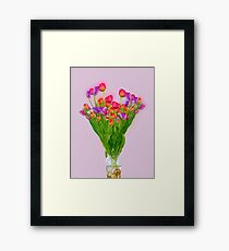 Tulips in a transparent glass vase Framed Print