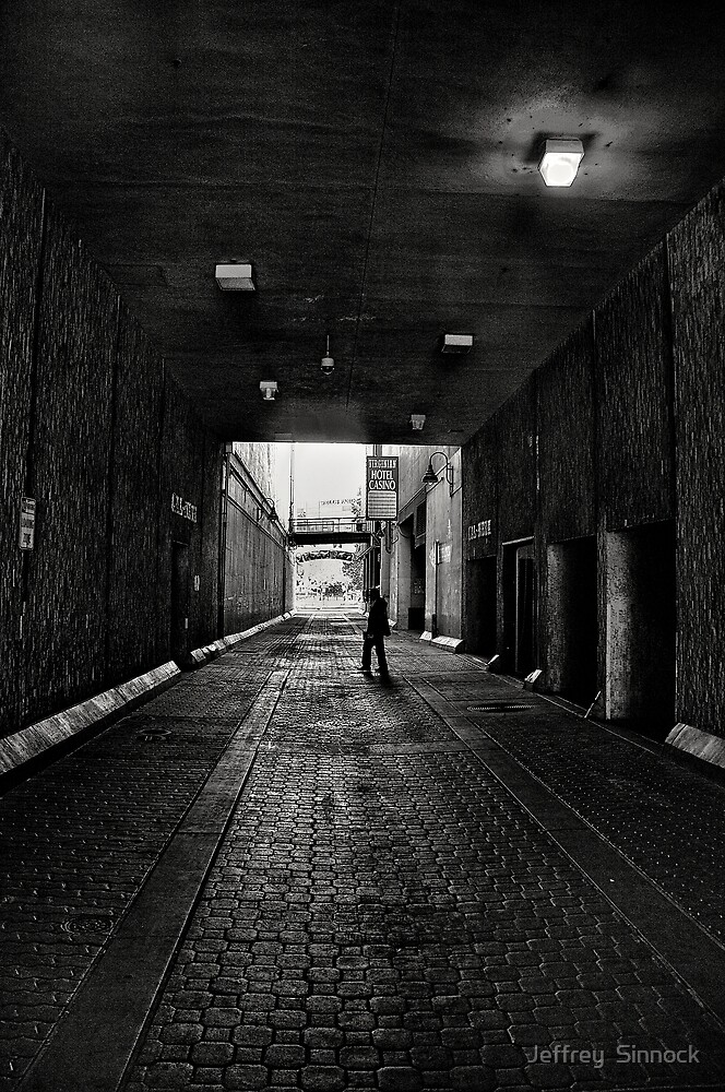 Man walking by Jeffrey  Sinnock