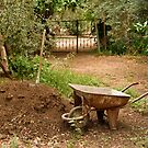 Wheel Barrow Next To Soil Heap by Kuzeytac