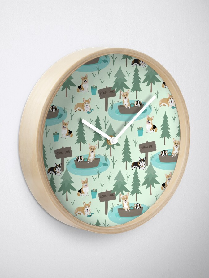 Alternate view of Corgis are fishing in the forest lake Clock