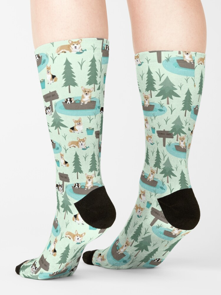 Alternate view of Corgis are fishing in the forest lake Socks