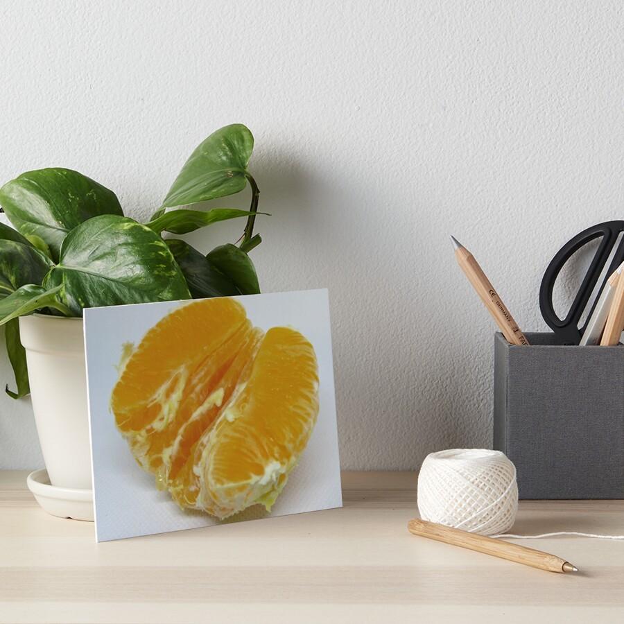 Half of orange fruit with juice drop dripping white paper Art Board Print