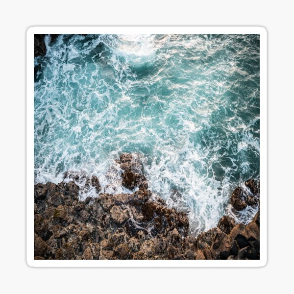 waves crashing on rocks Sticker