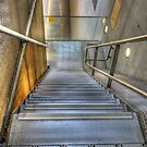 Staircase in a parking lot by Peter Wiggerman