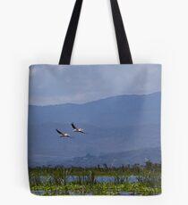 Pelicans flying over Lake Naivasha Tote Bag