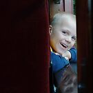 Noah and then his reflection on the sill of the train car. by Penny Fawver