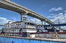 Cargo Boats docked at Potter's Cay under Paradise Island Bridge - Nassau, The Bahamas by Jeremy Lavender Photography