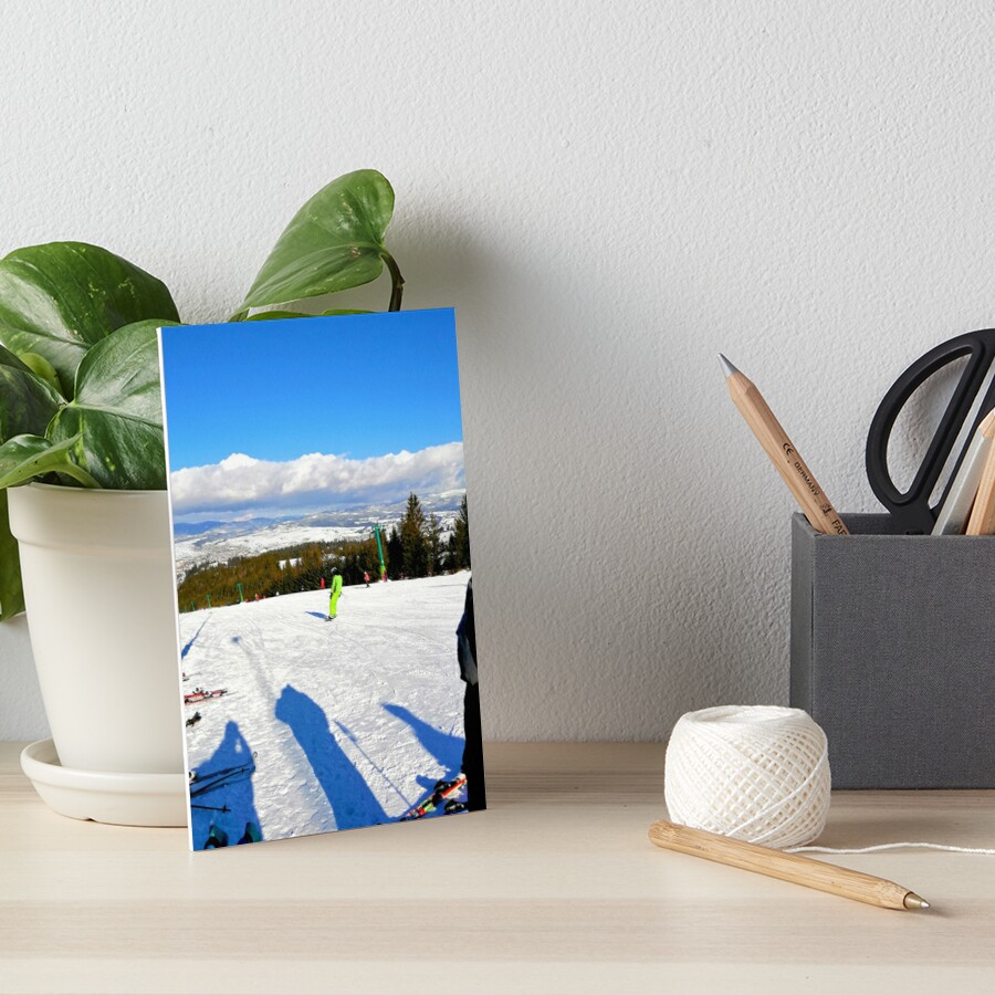 Landscape on the ski slope, sunny day, people feeling good, mountains in the distance, beautiful clouds in the sky Art Board Print