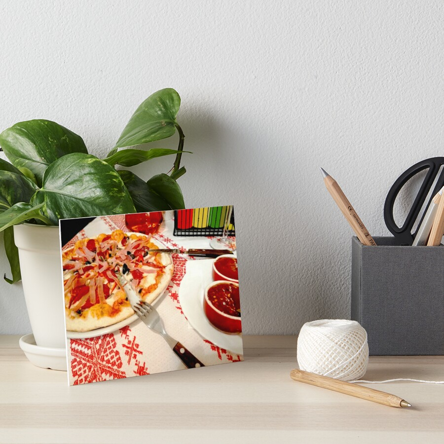 Table invitation, pizza, ketchup sauce, drink in the background, tablecloth with traditional motifs Art Board Print
