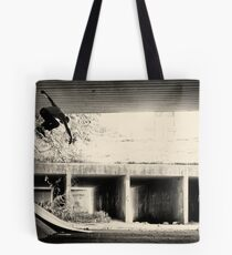 Jason Dill backside ollie by Sam Muller Tote Bag