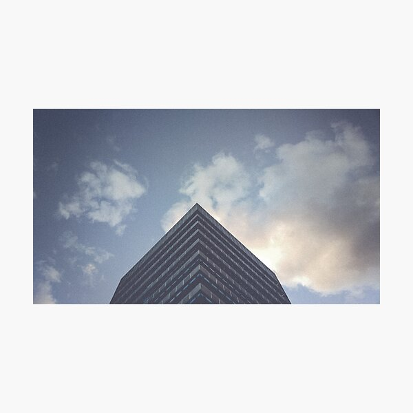 you build a pyramid. (Mendez Álvaro - Madrid).  The corners must have some kind of rattle for whoever takes photos. Or perhaps it is where the buildings are at stake, the transit between mediocrity and monumentality. This concrete Photographic Print