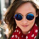 Beautiful woman wearing round sun glasses by Nando MacHado
