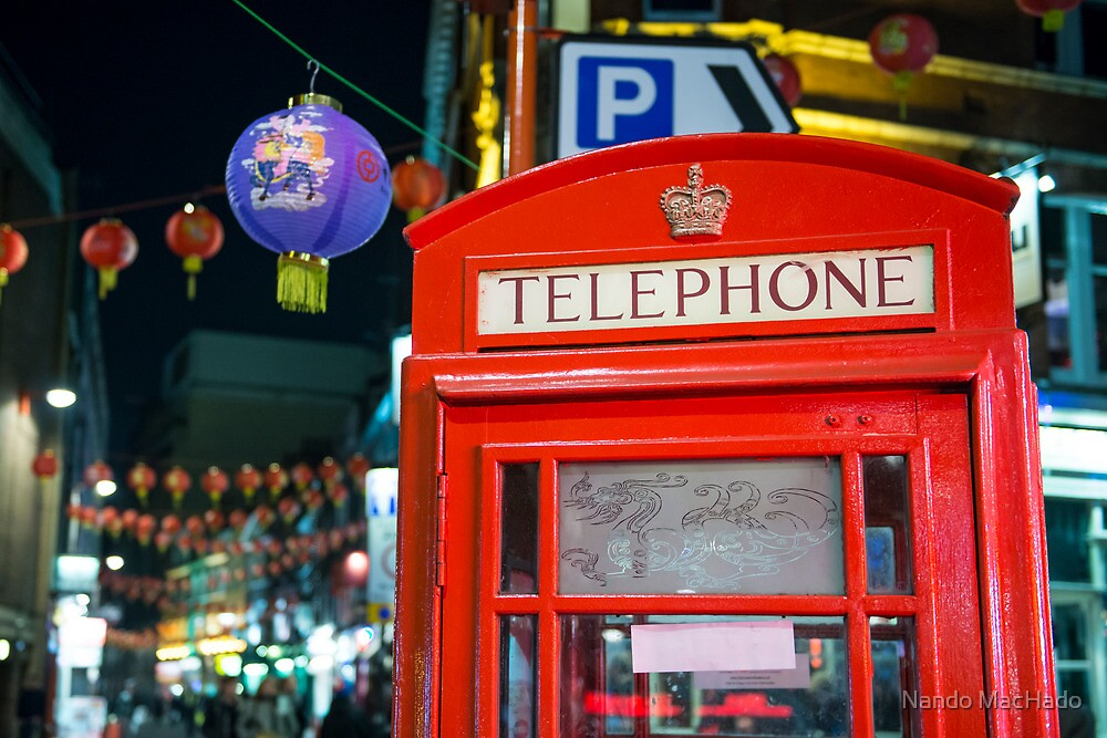 Red phone booth in Chinatown by Nando MacHado