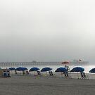 Blue umbrellas at Apache Pier by yakkphat