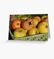 Rotten apple in the basket Greeting Card
