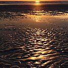 sunset on sand beach by naphotos