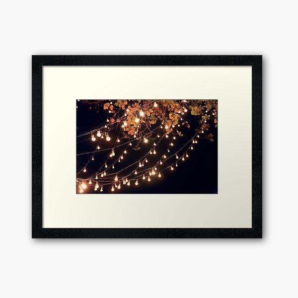 Lights draping off the Tree Framed Art Print