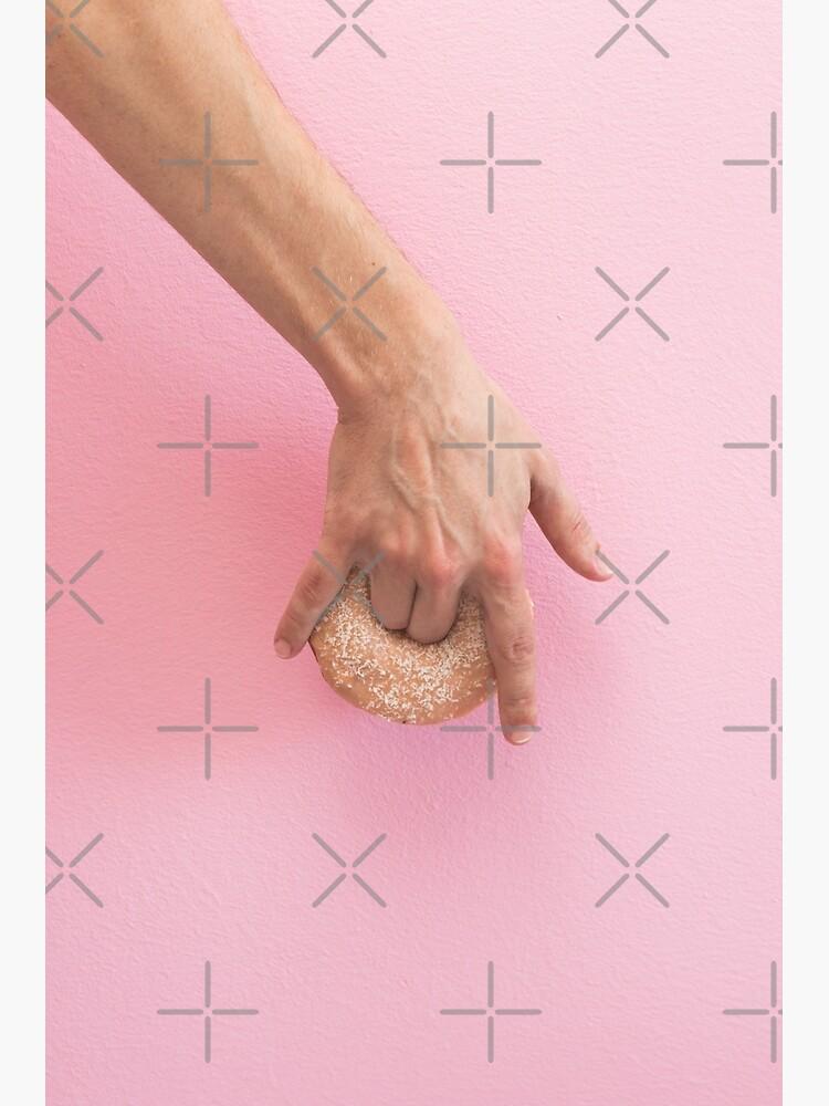 Hand holds donut by KatyaHavok