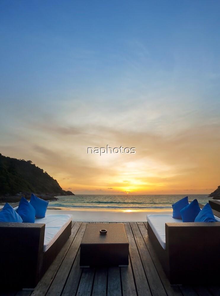 sunset on the beach by naphotos