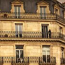 Woman on her balcony in Paris, France by Elana Bailey