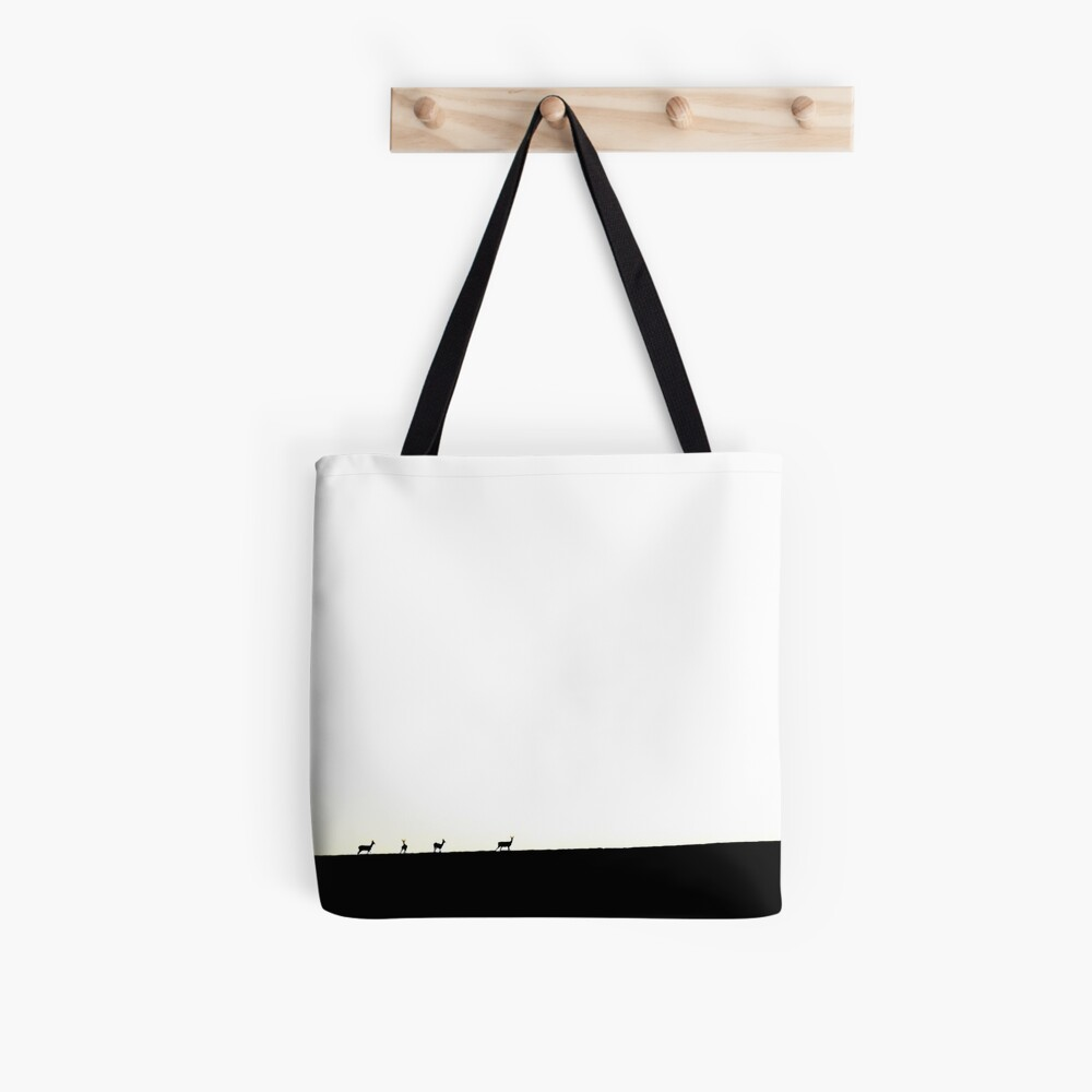 Deer figures, pixilated, silhouette, seen and photographed on a hill, at sunset, in the distance, games of shadows, lights and colors Tote Bag