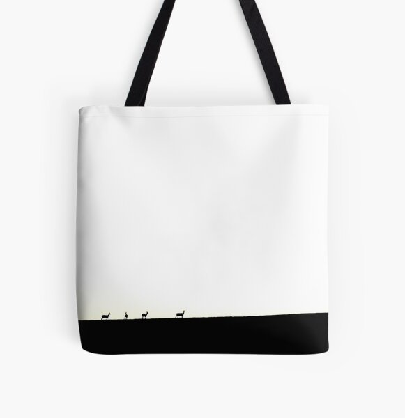 Deer figures, pixilated, silhouette, seen and photographed on a hill, at sunset, in the distance, games of shadows, lights and colors All Over Print Tote Bag