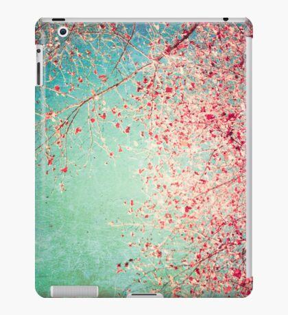 Pink autumn leafs on blue textured background iPad Case/Skin