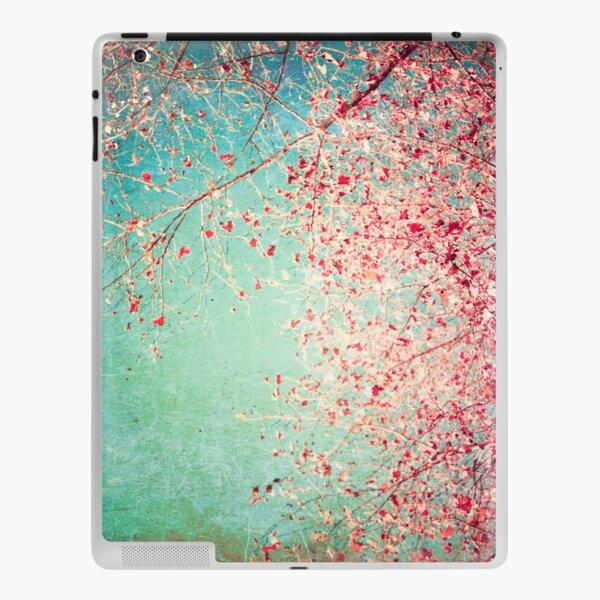 Pink autumn leafs on blue textured background iPad Skin
