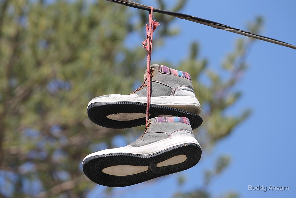 Shoes on a wire by Buddy Ahearn