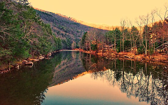 Mountain and setting sun reflection by Penny Fawver